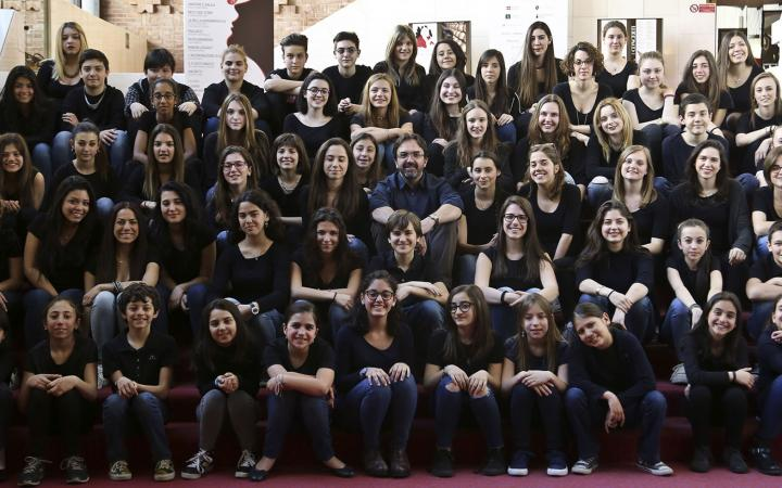 The Children Chorus of Teatro Regio and of Conservatory 'G. Verdi' of Turin with, in the middle, the chorus master Claudio Fenoglio