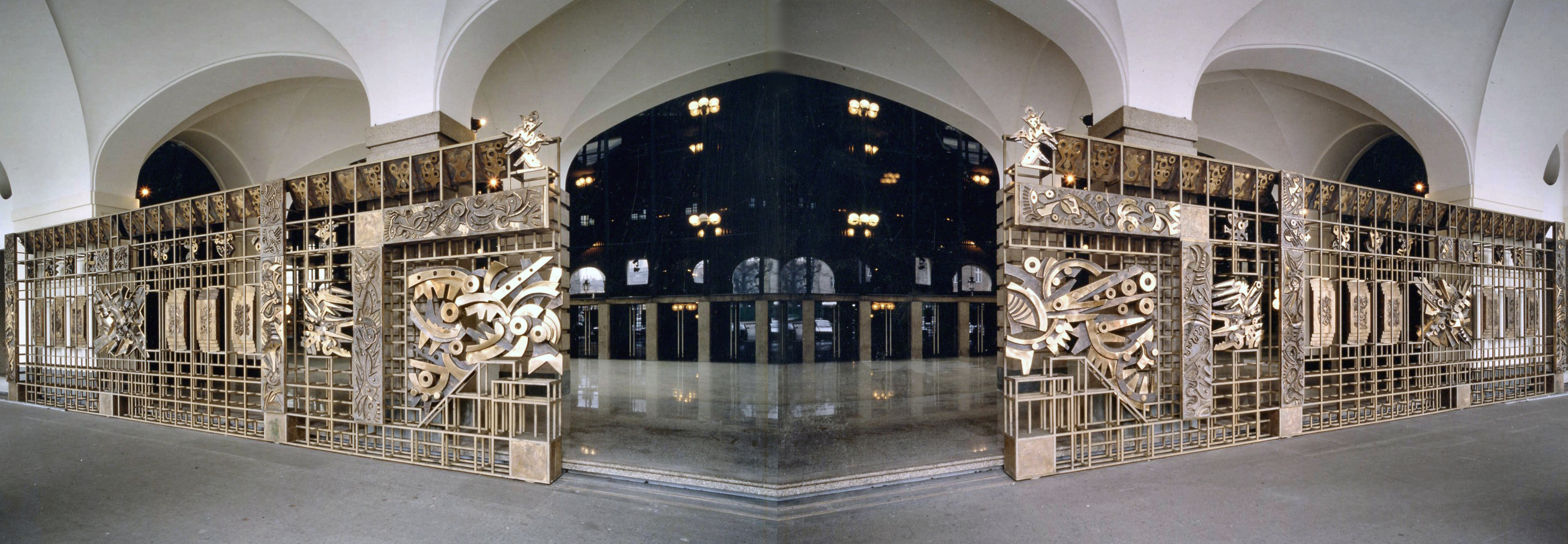 "Perspective photomontage of the main entrance of the Theatre with the bronze gate ""Odissea musicale"", by Umberto Mastroianni"